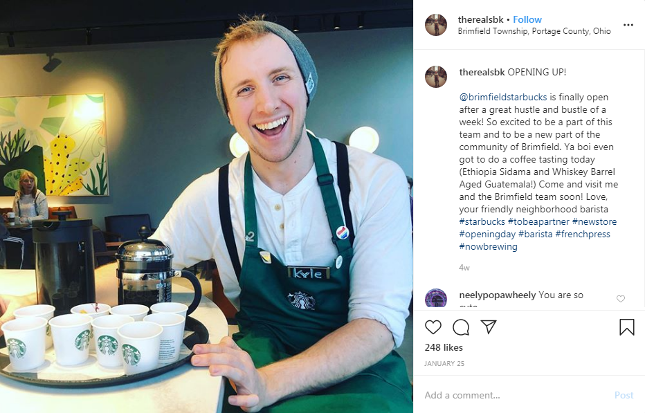 A Starbucks barista with Kyle written on name tag while smiling posted on Instagram.