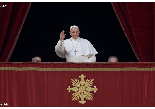 Pope Francis at the balcony of St Peter's Basilica, as he began his Christmas message ahead of the traditional Urbi et orbi Blessing.  - AP
