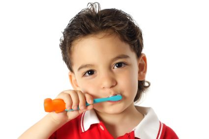 child boy brushes his teeth
