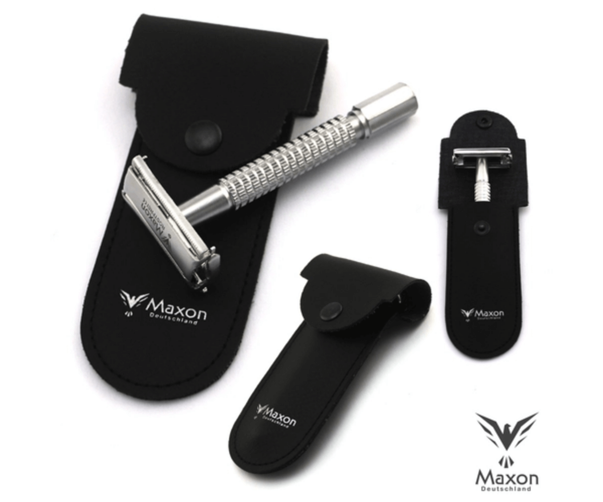 Stainless steel single blade razor laying flat across leather case.
