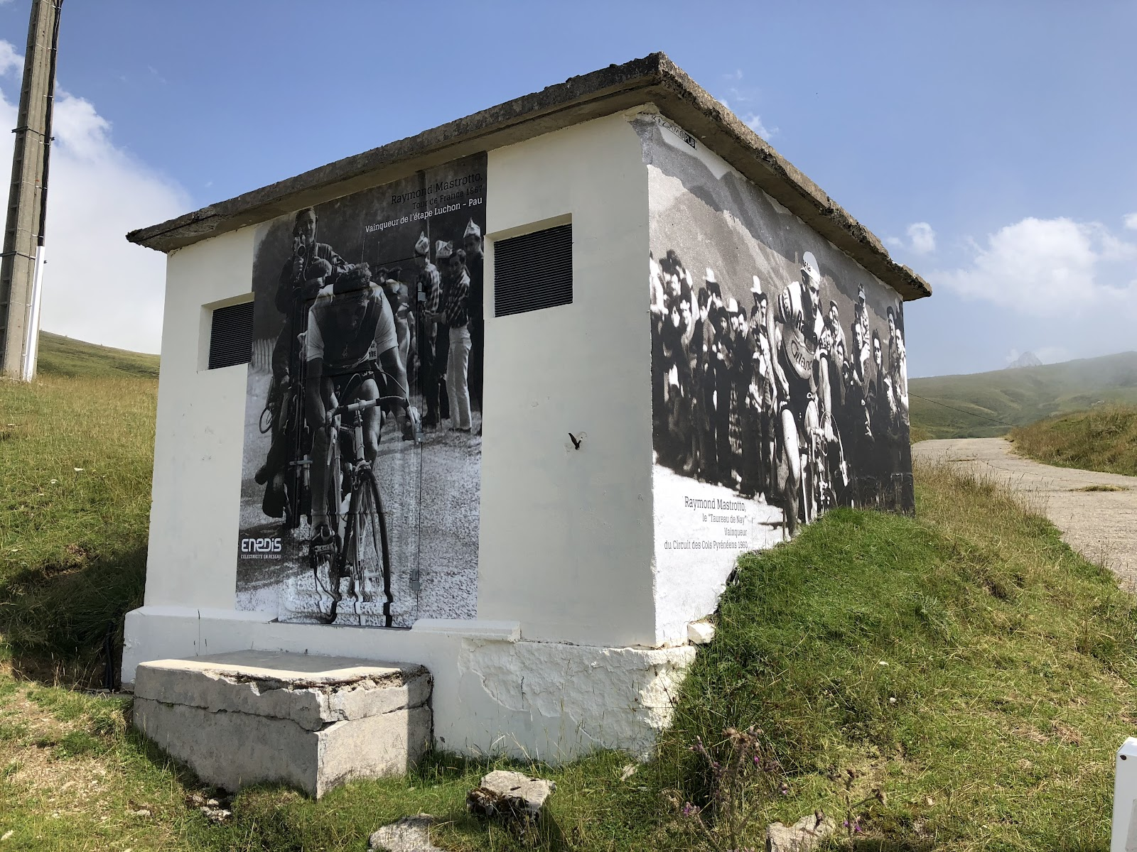 Bicycle ride up Col d'Aubisque  from Argeles Gazost - building with Tour de France photos on it