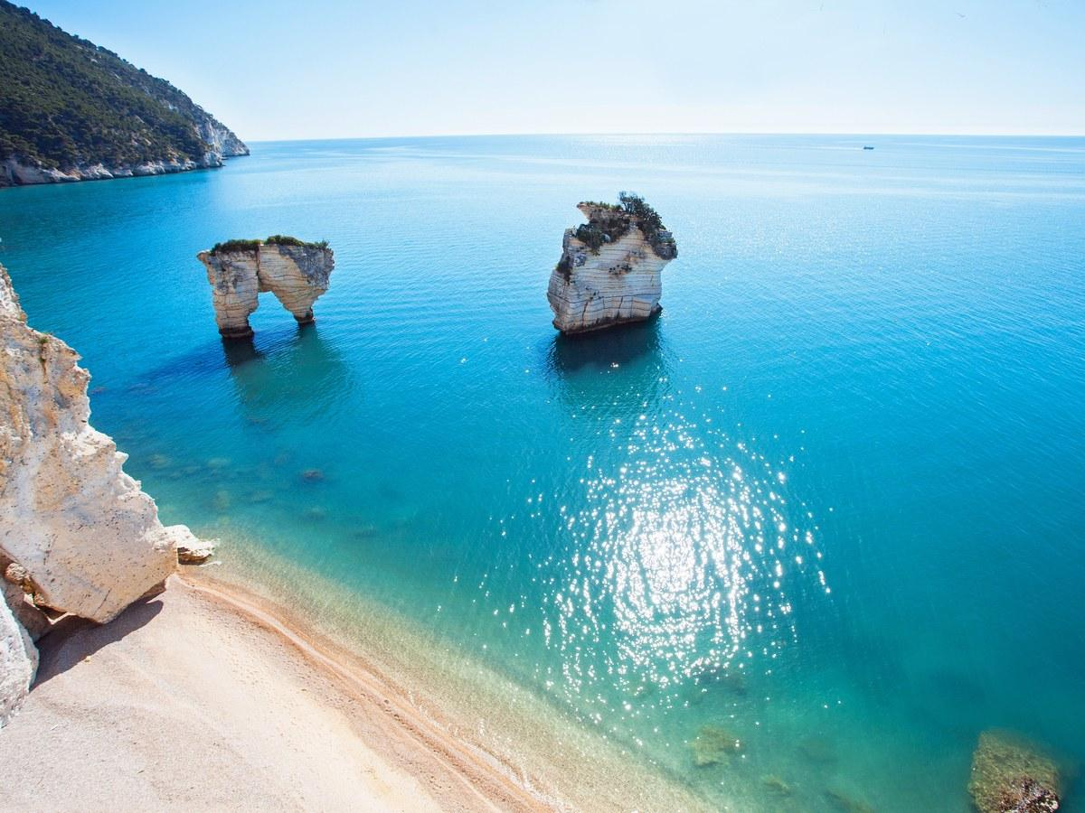 In Puglia's Gargano region (between Vieste and Mattinata) lies this powder-sand beach named after the indigenous local flower that blooms here in spring. Surrounded by protected parkland and with two white-rock formations set between varying shades of turquoise sea, the spot can be almost exclusively yours outside the high season of July and August.
