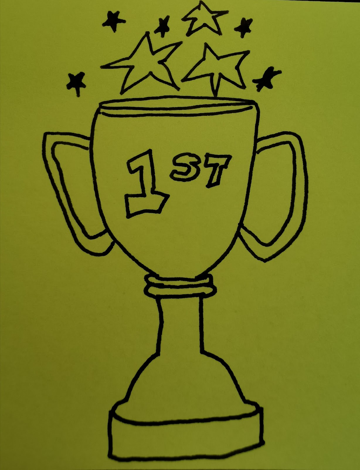 drawn trophy with stars coming our of the cup