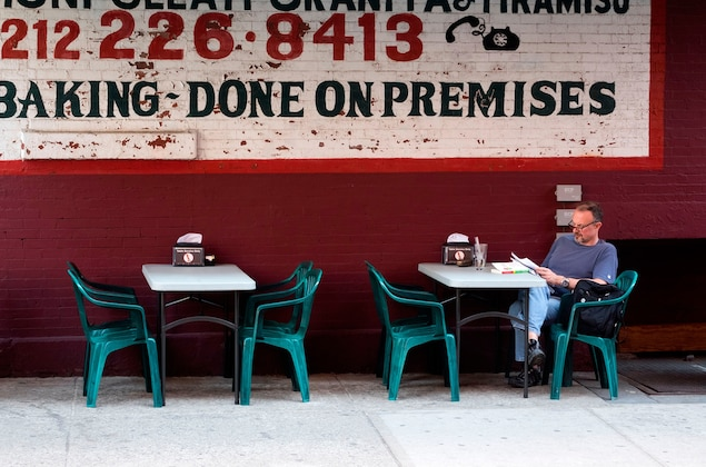 a man at a cafe dining in Little Italy, New York City, New York