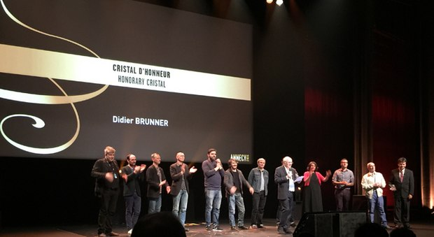Didier Brunner onstage at the closing ceremony with animators he has worked with