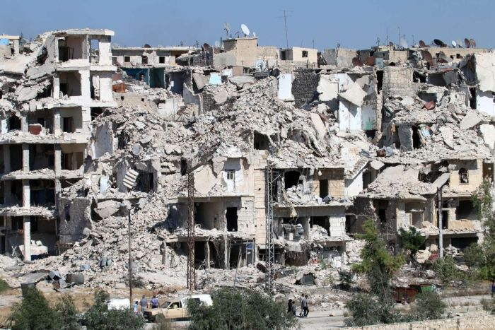 Heavily damaged buildings in the neighbourhood of Bani Zeid