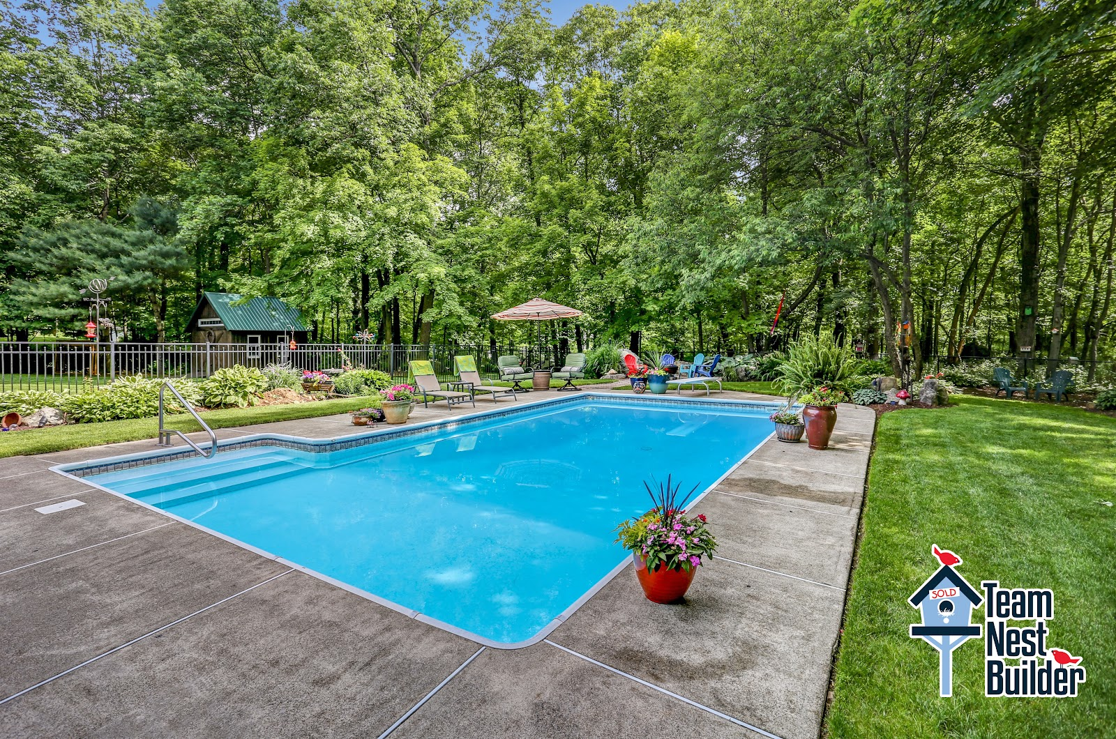 Heated pool with deck and fire pit area.