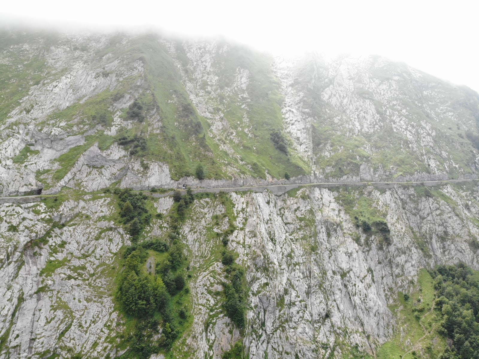 Cycling Col d'Aubisque  from Argeles Gazost - aerial drone photo from ravine of roadway and tunnel