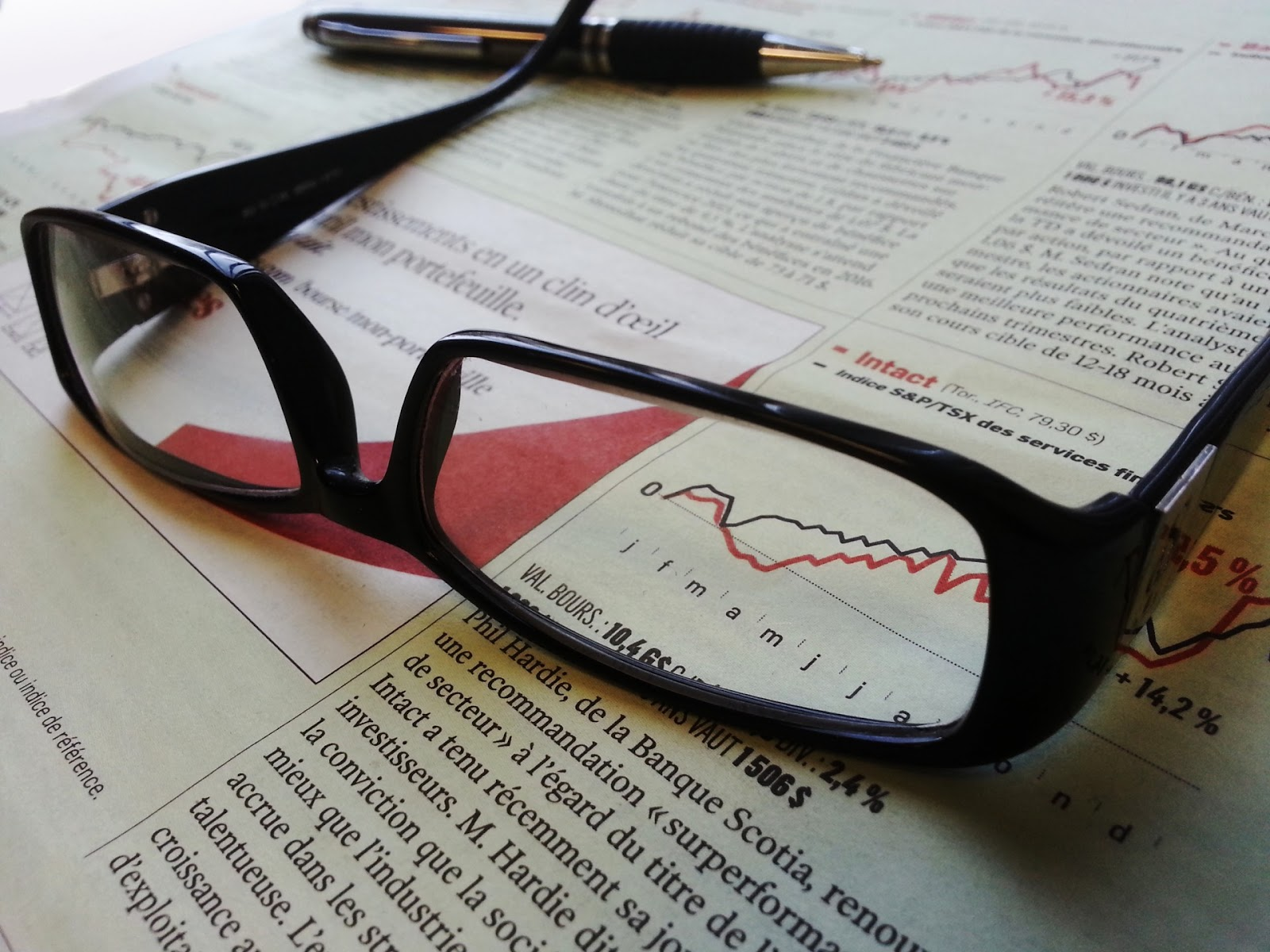 glasses-and-pen-on-a-newspaper.jpg