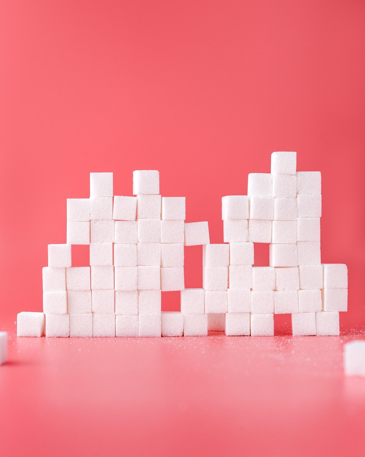 Stacked Sugar Cubes on Pink Background