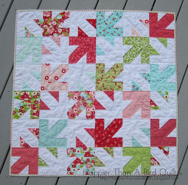 Quilt Featuring Patterned Arrows on White Background