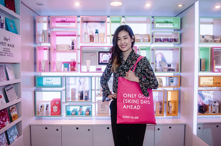 Charlotte Cho in a store with SOKO Glam products