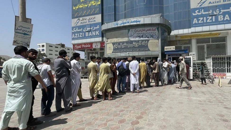 Queue of people trying to withdraw money