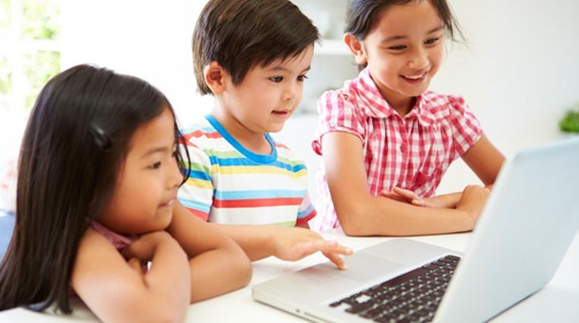 Learn Code Online - Three kids sitting browsing online