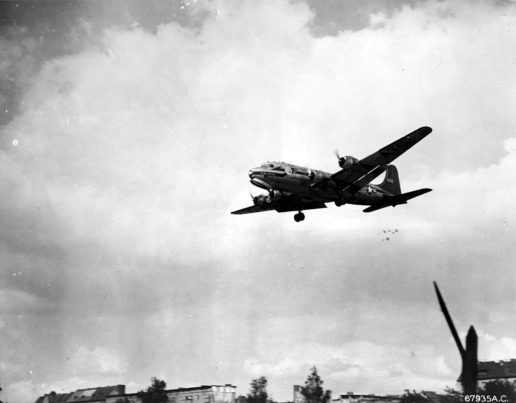 Plane dropping candy while flying low over West Berlin during the airlift.