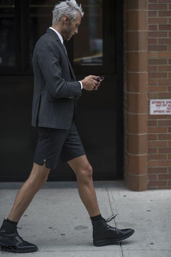 man wearing shorts and blazer