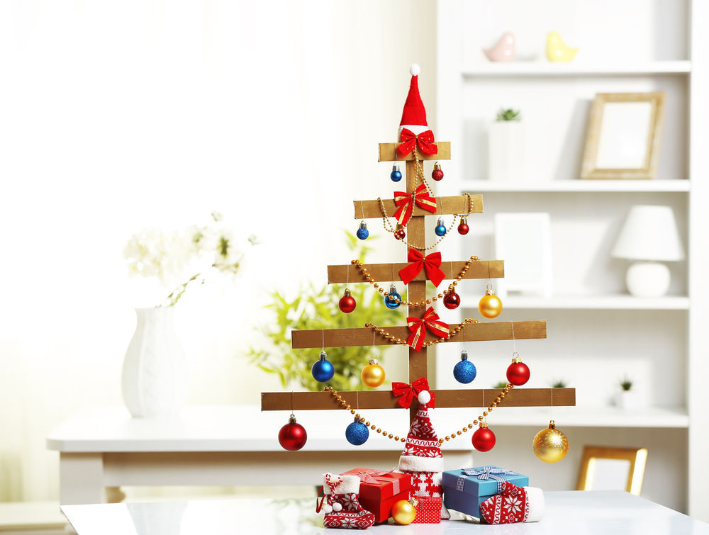DIY Mini Christmas tree made with wooden dowels hung with ornaments