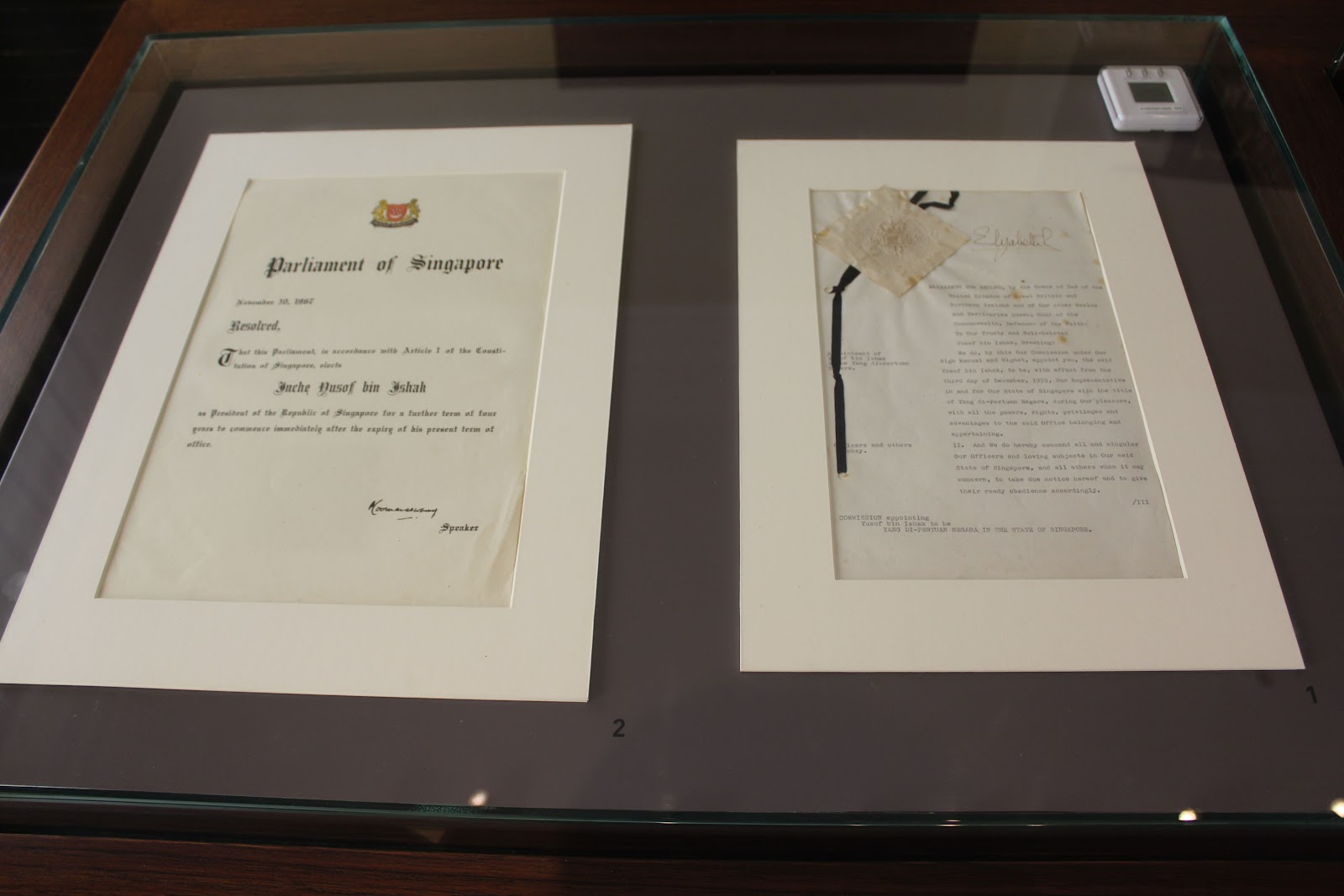 Signed documents signifying Singapore's independence and self-governance