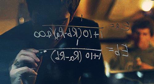 Eduardo Saverin (Andrew Garfield) works on an algorithm with Mark Zuckerberg (Jesse Eisenberg)