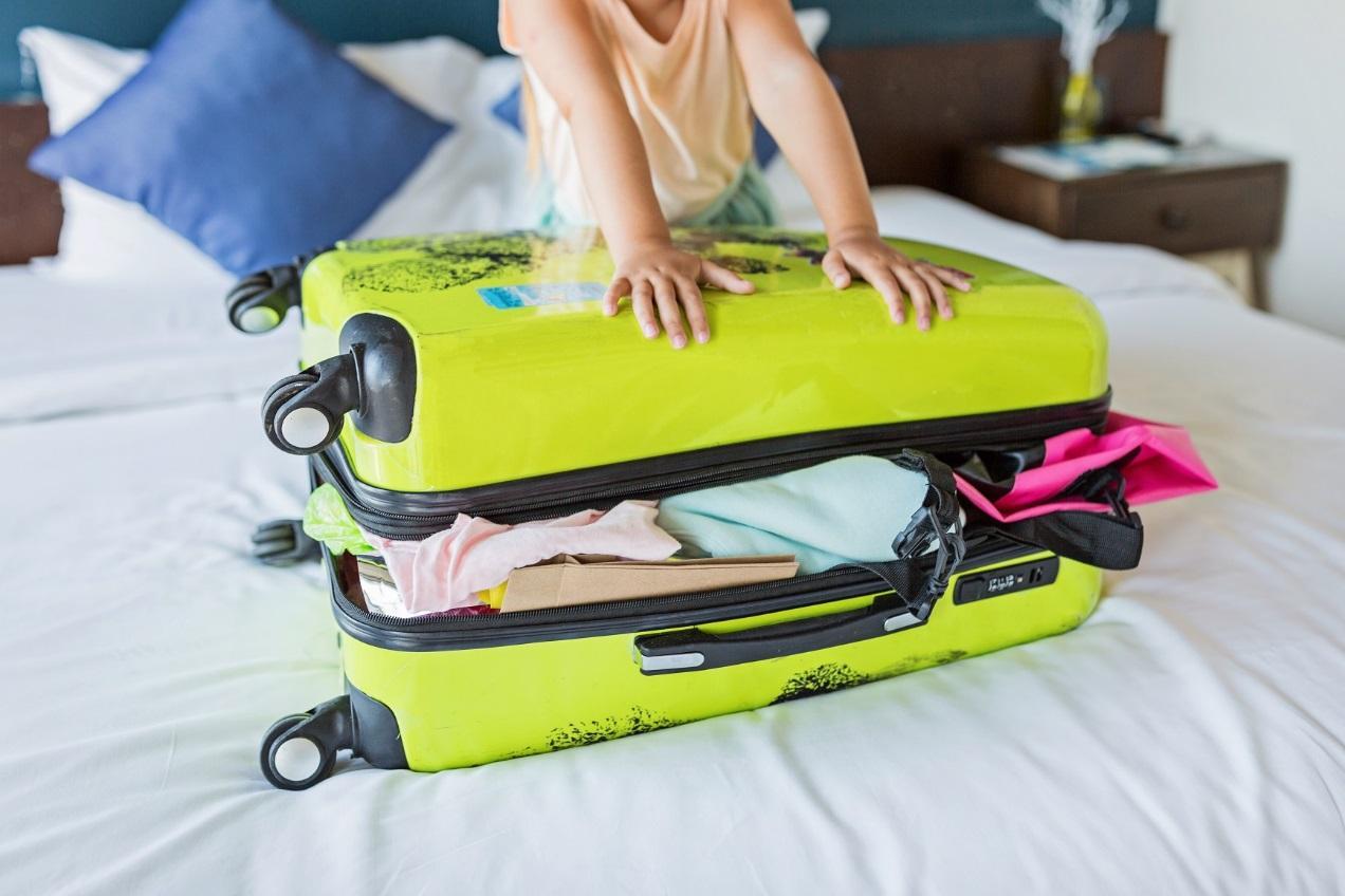 C:UsersivlevDownloadskid-packing-suitcase-on-bed-for-summer-vacations-4M53UJ4.jpg