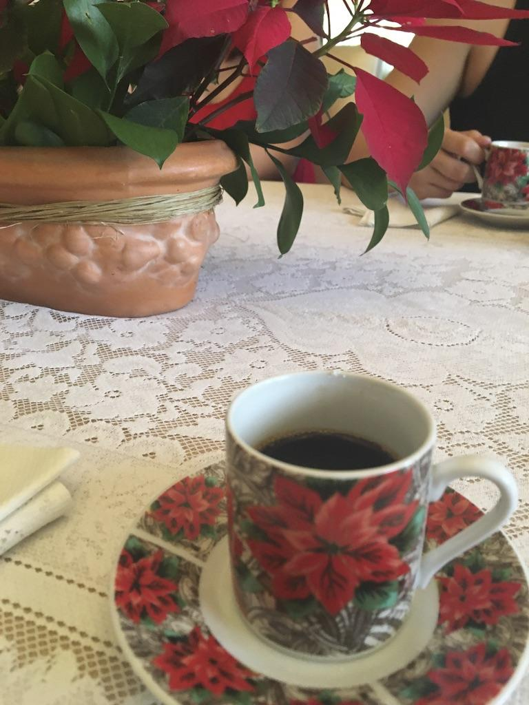 A cup of coffee on a table  Description automatically generated