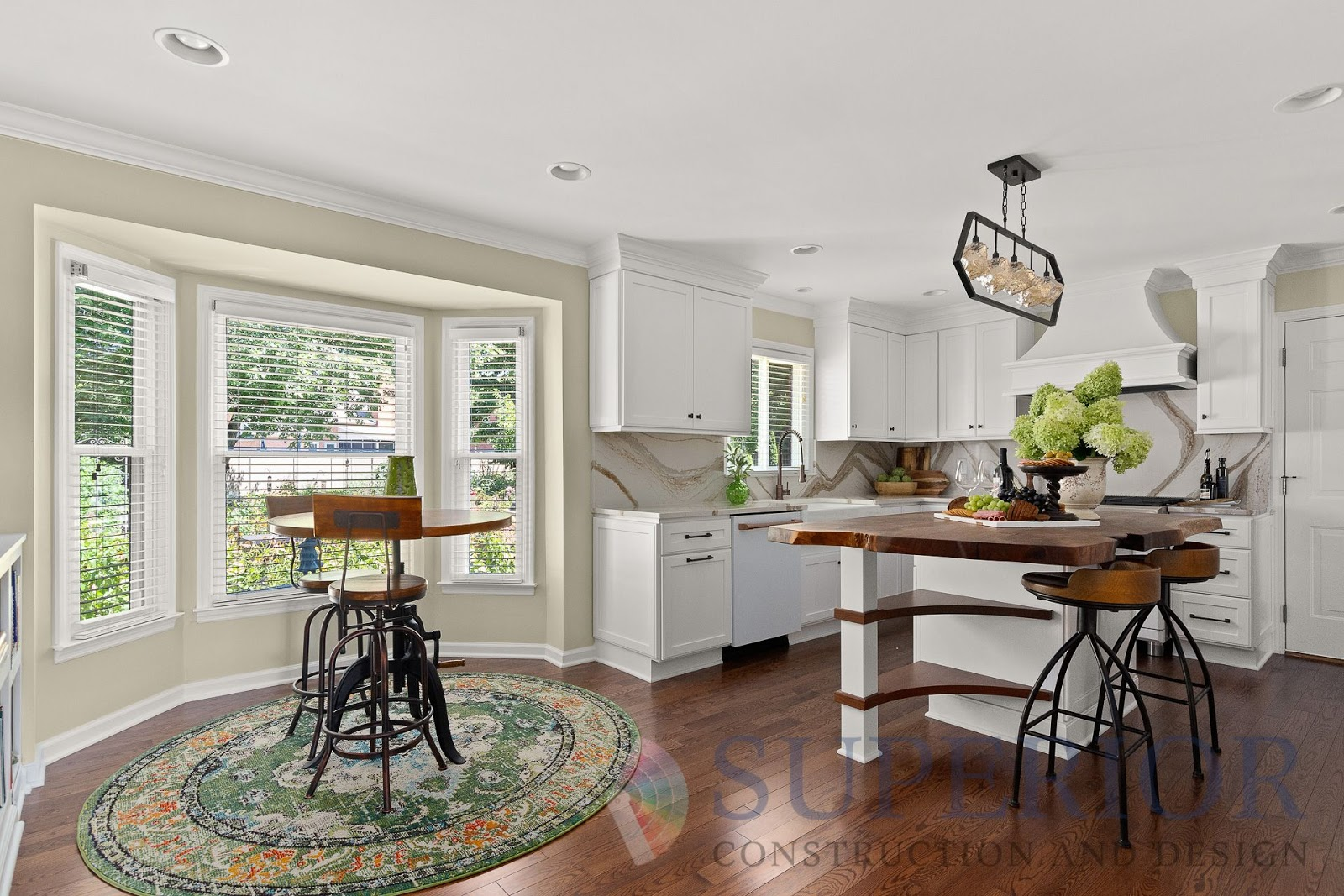 superior construction and design create a multi-functional space kitchen dining with green and brown accents