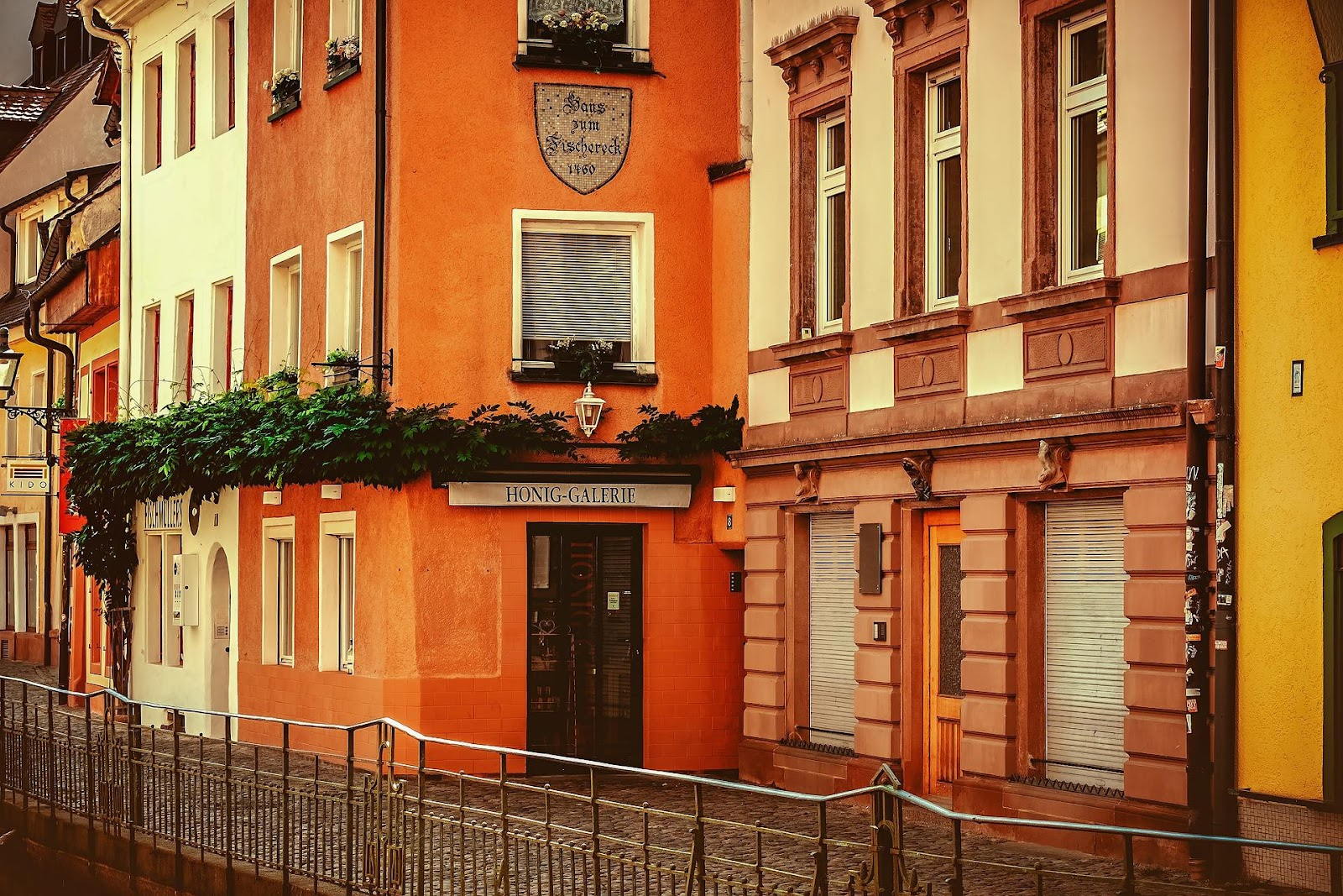 red white and orange traditional medieval buildings in freiburg germany