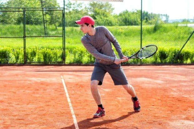Tennis Player Hitting Backhand Shot