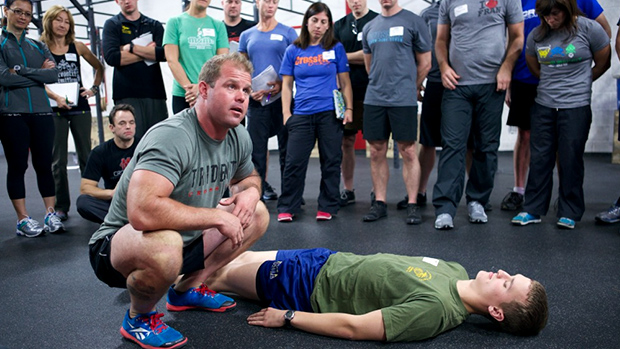 Dr. Kelly Starrett coaching an athlete