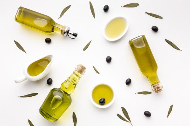 Olive oil saucers and bottles Free Photo
