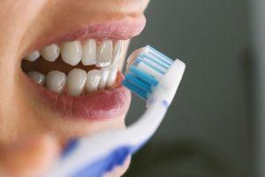 young-woman-brushing-teeth