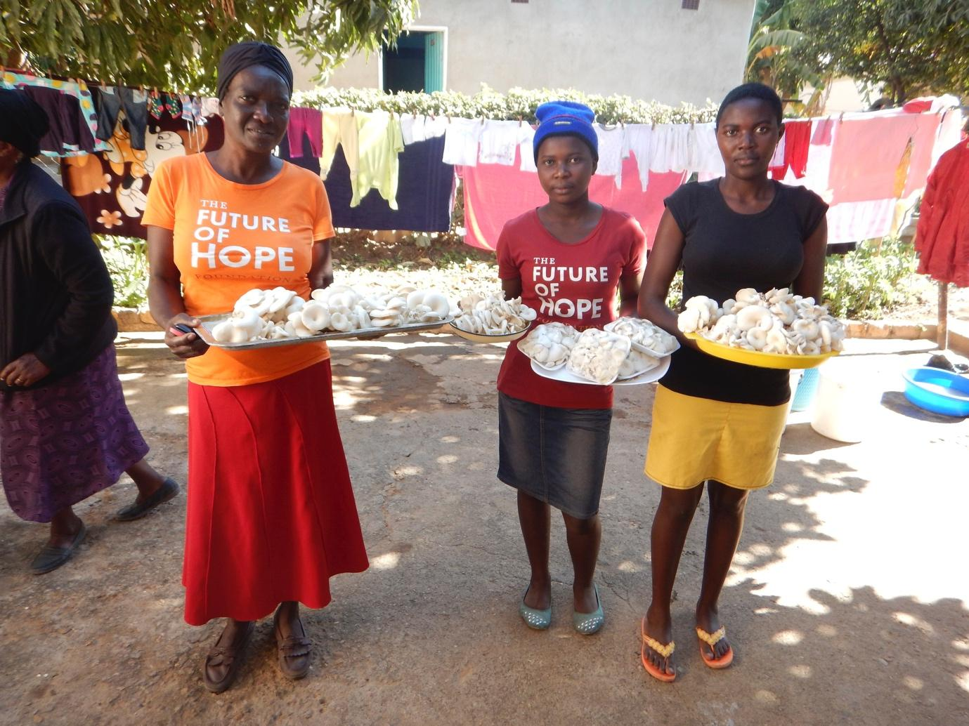 Community women from Kwekwe with their harvest of the day. Credit: The Future of Hope Foundation.