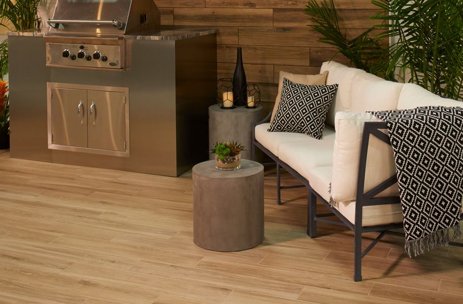 wood-look tile as flooring and backsplash in bbq area