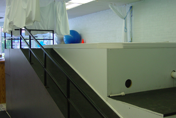 Another example of an above ground pool viewed from the side, showing ramp