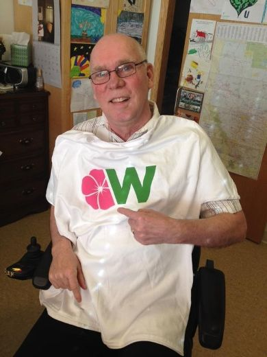 Former municipal councillor Dave Kirschner poses with a Wildrose shirt at his long-term care facility in Edmonton. Supplied Image/Iris Kirschner