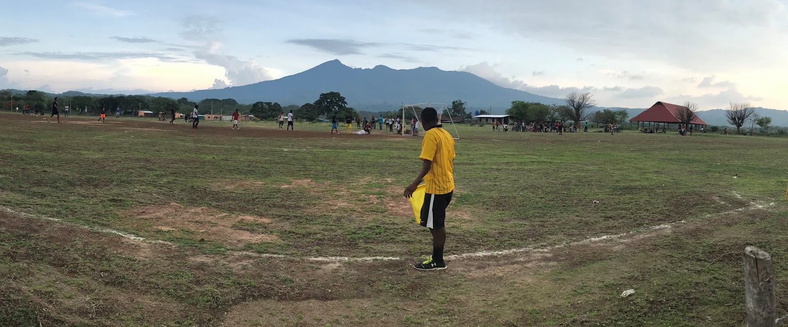 Bike climb of Mombacho Volcano - soccer field with volcano in background