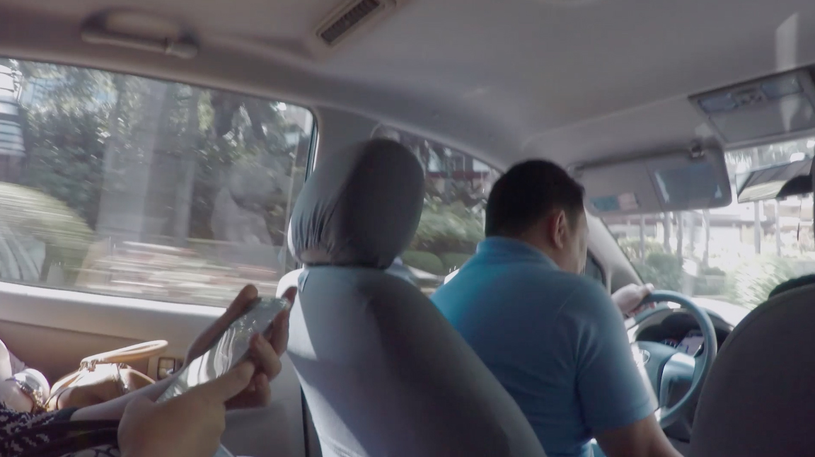 Inside an UberHop in Manila, Philippines. UberHop is a shared ride with other passengers, following predefined stops, similar to a public bus. Photo: Arthur Röing Baer