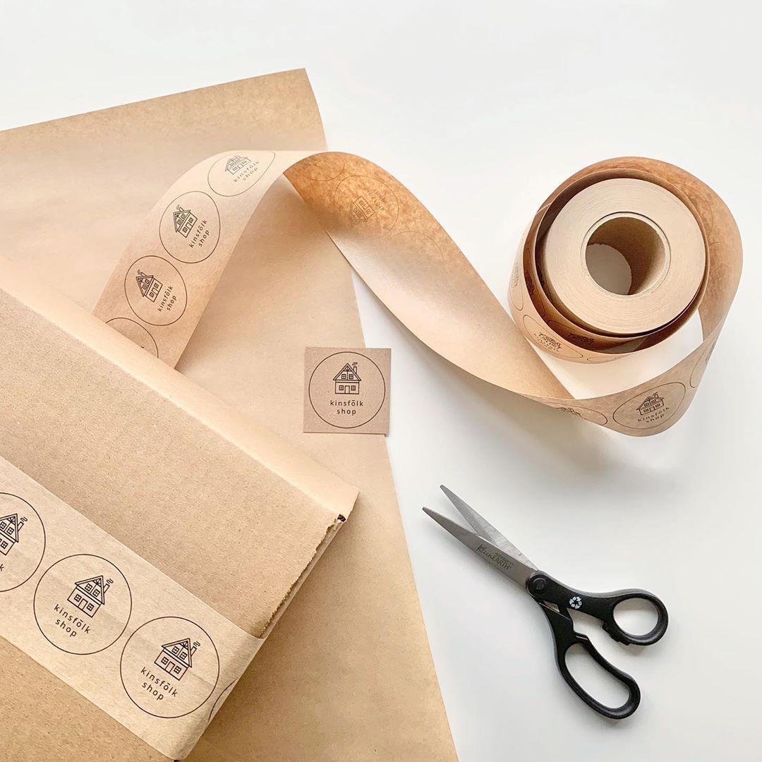 Custom tape, a box and scissors