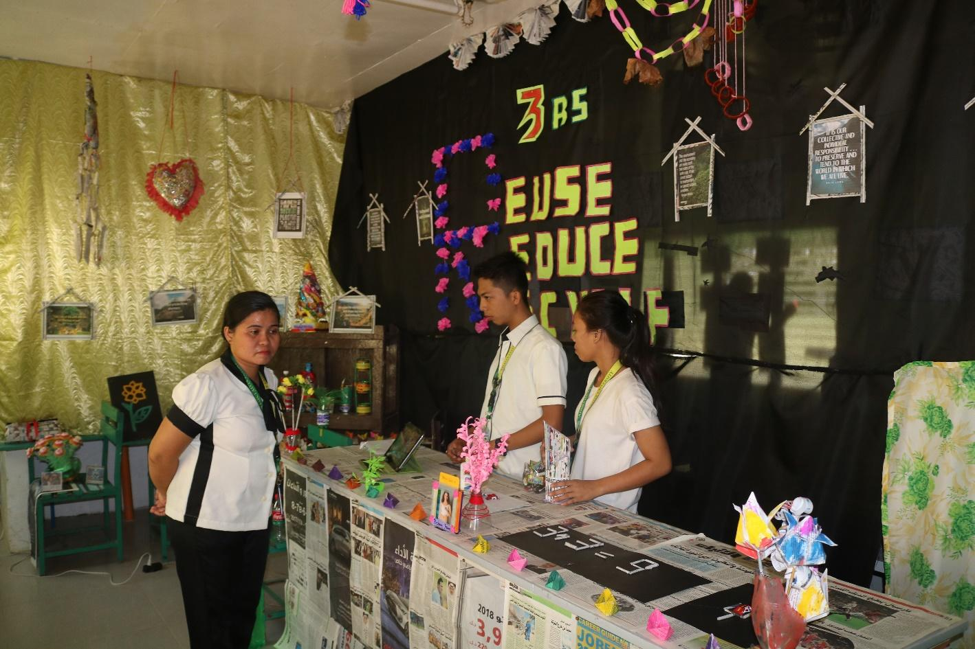 AT A GLANCE. BSEd students actively participating in the Science Fair
