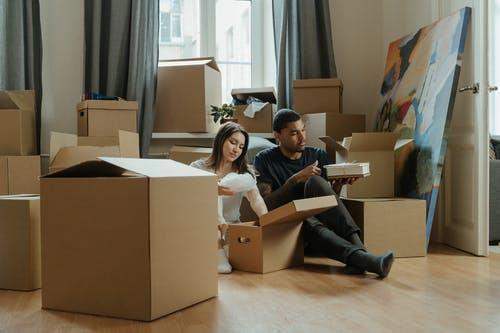 2 Boys and Girl Sitting on Brown Cardboard Box