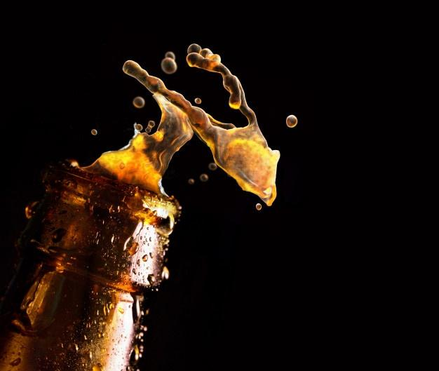 Bottle of beer with water drop falling