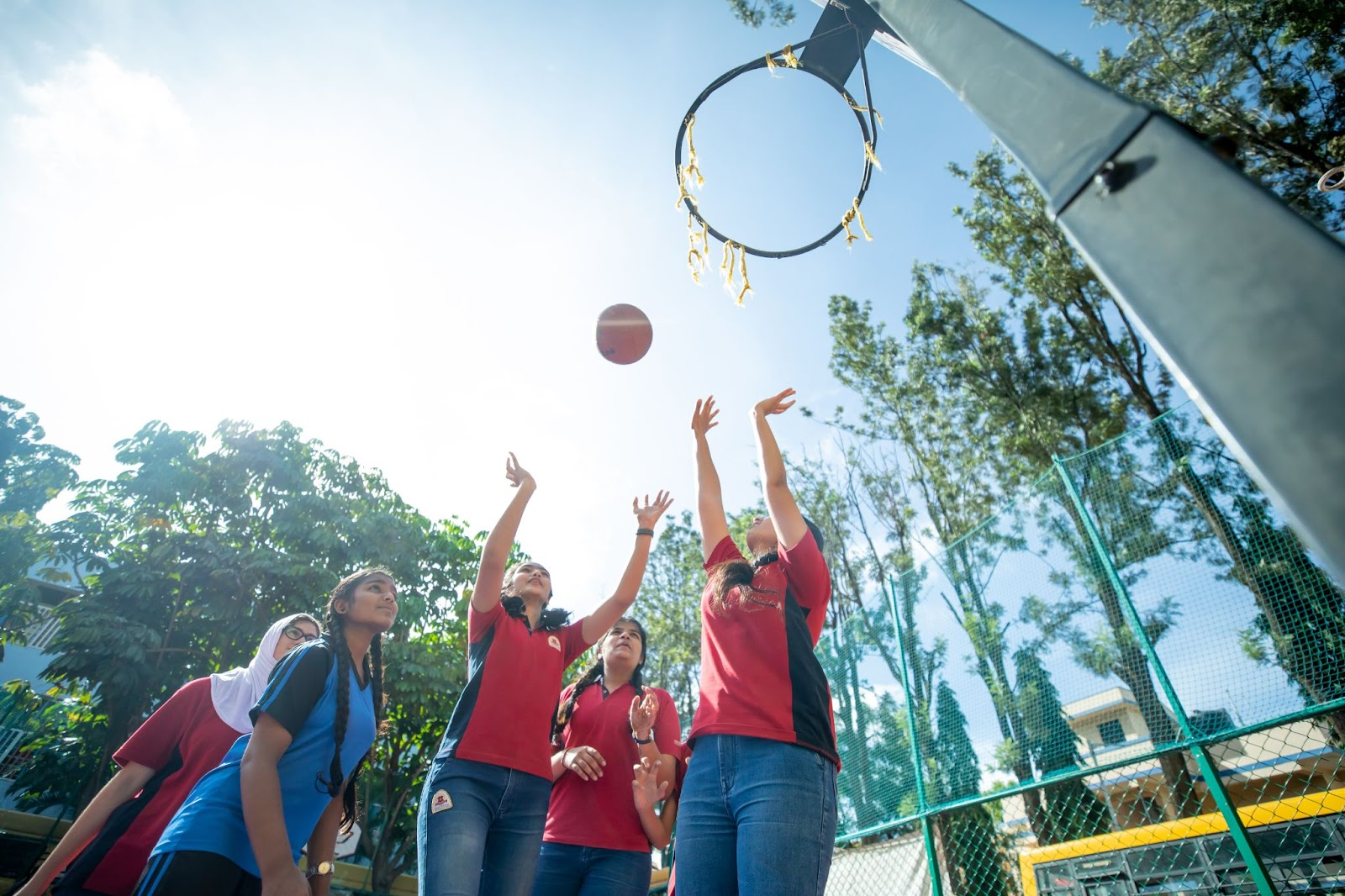 children playing basketball as an extracurricular activity in Orchids school