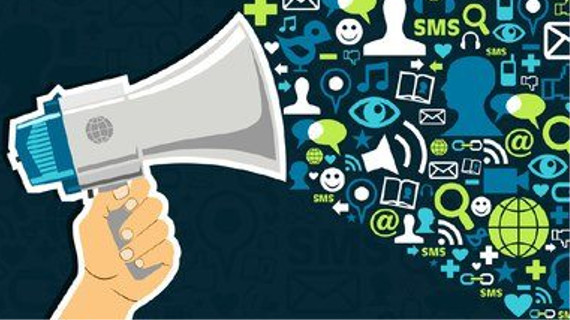 A megaphone is being held with all forms of social media pouring out, it's information overload.
