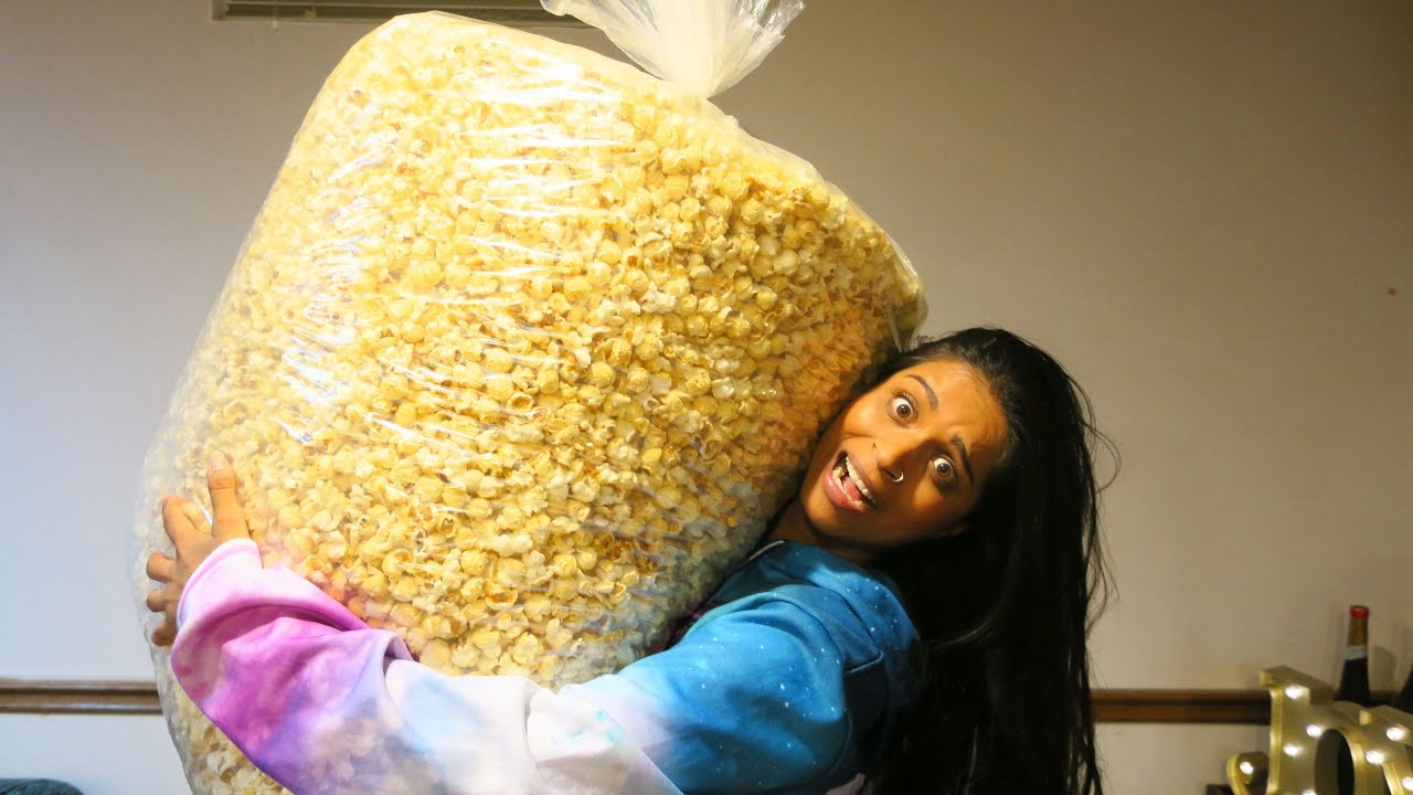 Image result for lilly singh eating popcorn