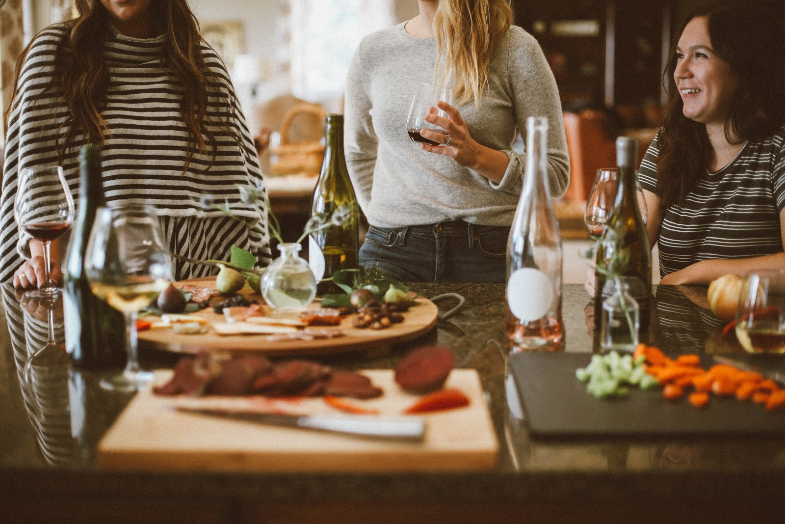 women enjoying wine with food
