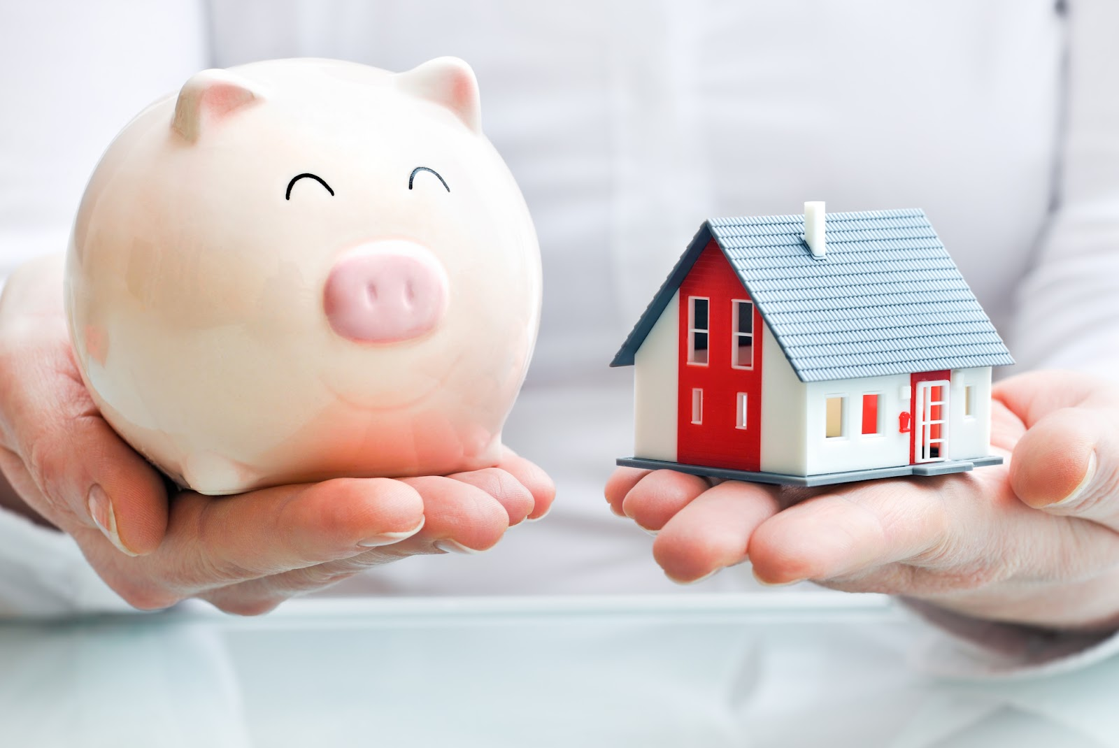 a toy home and a piggy bank for alternative mortgage financing options