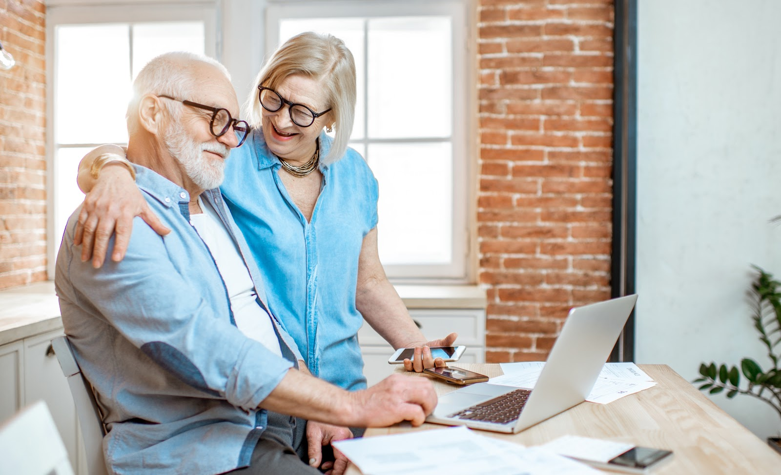 How often are dividends paid: A couple uses a computer together