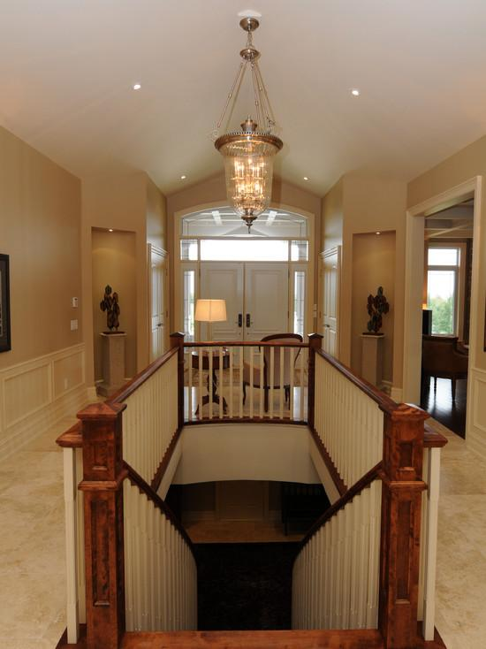 http://www.claffisica.org/wp-content/uploads/2014/01/Stunning-Traditional-Staircase-Design-with-Wooden-Steps-and-Balustrade-in-Horse-Haven-with-Fancy-Classic-Chandelier.jpg