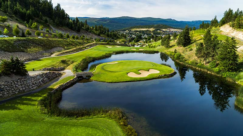 A golf hole at Black Mountain Golf Club with an island green surrounded by water.