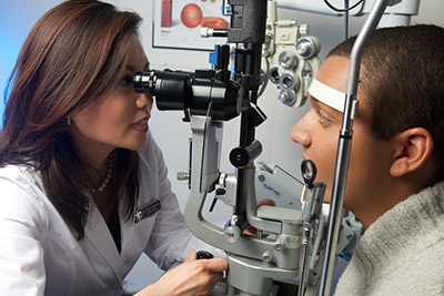 Eye doctor examining a patients vision